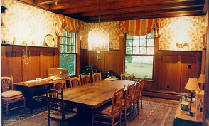 Grand dining room with restored wainscot paneling.