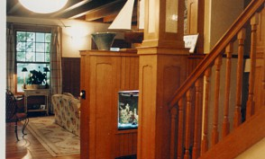 A formerly dark enclosed stair is opened up with new matching illuminated newel post,stringer and balustrade.